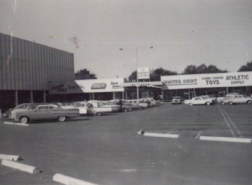 Center of Westgate, with the Lion Store on the left, circa 1965. Courtesy of the Toledo-Lucas County Public Library, obtained from http://images2.toledolibrary.org/.