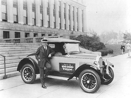 John North Willys shows off the 100,000th Whippet in front of the administration building.